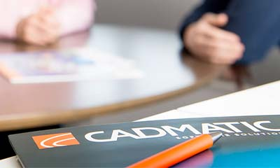 CADMATIC brochure on the table